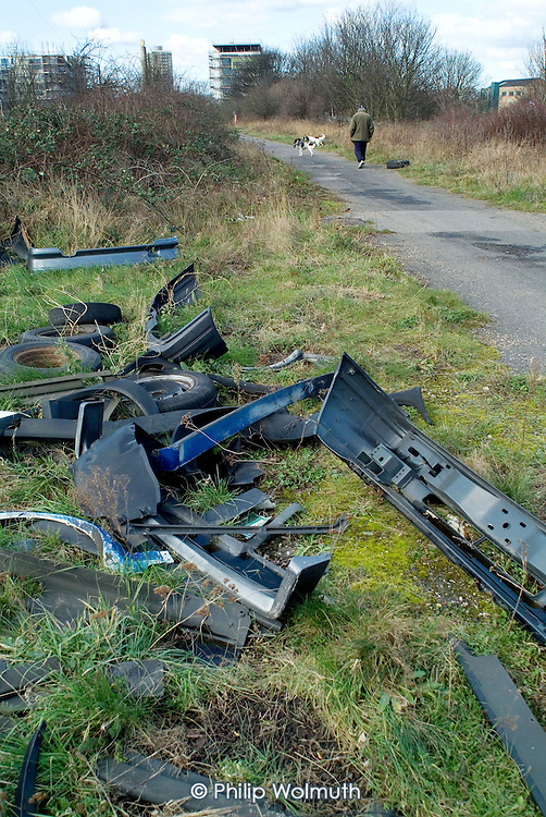 Vandalised car parts on Greenway, the footpath which passes through neglected parkland on the proposed site in Stratford, East London, on which a new Olympic Stadium will be built if London's bid for the 2012 Games is successful.