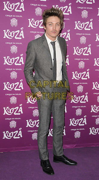"Tyler James .VIP Night for Cirque du Soleil's new production, ""Kooza"" at the Royal Albert Hall, London, England..January 8th 2013.full length grey gray suit white shirt  .CAP/CJ.©Chris Joseph/Capital Pictures."