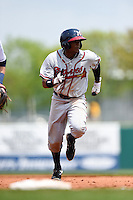Mississippi Braves outfielder Cedric Hunter (17) runs the bases during a game against the Montgomery Biscuits on April 22, 2014 at Riverwalk Stadium in Montgomery, Alabama.  Mississippi defeated Montgomery 6-2.  (Mike Janes/Four Seam Images)