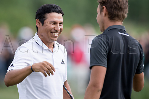 25th June 2017, Golf, Moosinning, Germany;  Argentinian  Andres Romero is happy together with Joakim Lagergren of Switzerland after the men's singles 4th round at the International Open European Tour in Moosinning, Germany, 25 June 2017. Romero is the winner of the Golf International Open 2017.
