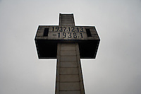 A large cross sculpture marks the site of a mass grave at the Memorial Hall of the Nanjing Massacre in Nanjing, Jiangsu, China on Dec. 13, 2009.  On Dec. 13, 2009, thousands of people visited The Memorial Hall of the Nanjing Massacre in Nanjing, Jiangsu, China, to remember those who died at the hands of Japanese soldiers in 1937-8.  The day marked the 72nd anniversary of the start of the massacre. The historical account has always been mired in controversy, and differing opinions on what actually happened have been a consistent obstacle to relations between China and Japan.  China's official account of history states that 300,000 people were killed by Japanese forces over a 6-week period starting Dec. 13, 1937