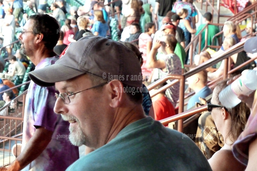 Profile of a fan in the bleachers. Furthur Band at McCoy Stadium, Pawtucket RI on 5 July 2012
