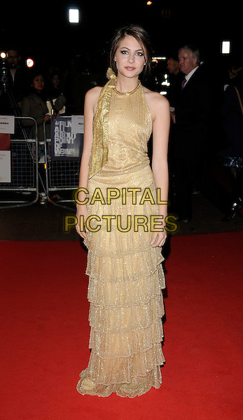 "WILLA HOLLAND .The ""Genova"" UK premiere, London Film Festival, Day 8, Odeon West End cinema, London, England..October 22nd, 2008.LFF full length gold sleeveless dress layers layered bow halterneck .CAP/CAN.©Can Nguyen/Capital Pictures."