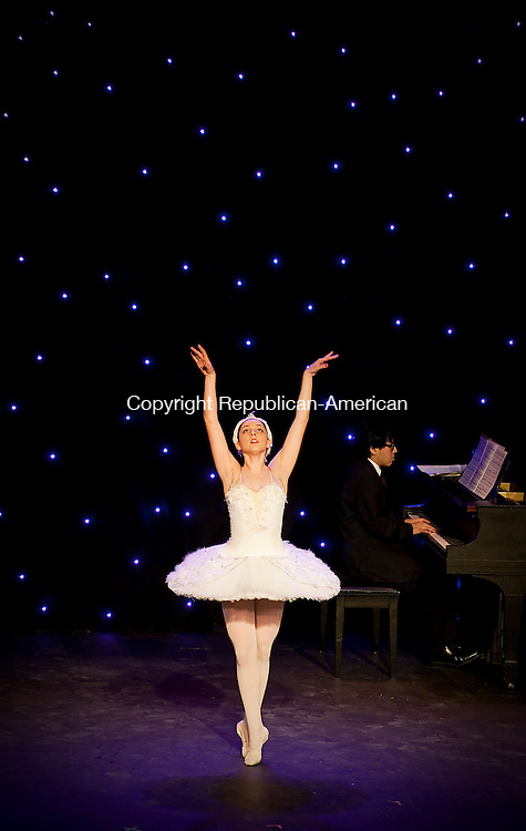 THOMASTON,  CT-122114JS03- A ballerina performs during a special &quot;Cello-bration&quot; holiday concert led by concert cellist Thirzah Bendokas, Sunday at the Thomaston Opera House. <br />  Jim Shannon Republican-American
