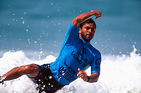Sunny Garcia (HAW) Upset with the judges and his loss during the running of the Gotcha Lacanau Pro at Lacanau Beach, in the South West of France. Circa 1995. Garcia later picked up a muffin and hurled it at the judges stand. The judges actually thought it was a rock and had ducked away from the glass front as it came towards them. Garcia was fined for his outburst. Photo: joliphotos.com