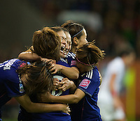 Homare Sawa (10) of Japan celebrates her game-tying goal with teammates  during the final of the FIFA Women's World Cup at FIFA Women's World Cup Stadium in Frankfurt Germany.  Japan won the FIFA Women's World Cup on penalty kicks after tying the United States, 2-2, in extra time.