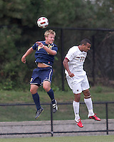 Quinnipiac University forward Philip Suprise (15) and Boston College defender Stefan Carter (23) battle for head ball. Boston College defeated Quinnipiac, 5-0, at Newton Soccer Field, September 1, 2011.