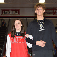 RICK PECK/SPECIAL TO MCDONALD COUNTY PRESS<br /> Senior king candidate Boston Dowd is escorted by Ragan Wilson.