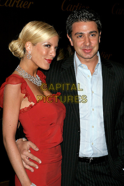 TORI SPELLING & CHARLIE SHANIAN.Cartier Celebrates 25 Years In Beverly Hills In Honor Of Project A.L.S. held on Rodeo Drive..May 9th, 2005.Photo Credit: Jacqui Wong/AdMedia.half length husband wife married red dress diamond neklace arm around waist.www.capitalpictures.com.sales@capitalpictures.com.© Capital Pictures.