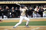 Chase Mascolo (28) of the Wake Forest Demon Deacons follows through on his swing against the Louisville Cardinals at David F. Couch Ballpark on March 18, 2018 in  Winston-Salem, North Carolina.  The Demon Deacons defeated the Cardinals 6-3.  (Brian Westerholt/Sports On Film)