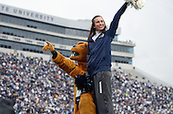 November 2, 2013  (State College, Pennsylvania)  The Penn State Nittany Lion mascot pumps up the crowd with a cheerleader at Beaver Stadium November 2, 2013. (Photo by Don Baxter/Media Images International)