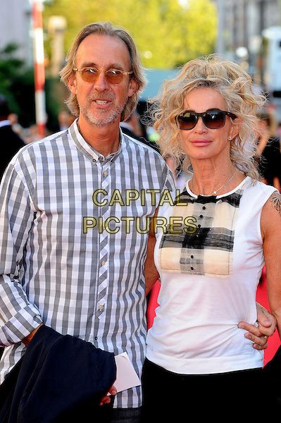Mike Rutherford and Angie Rutherford.Arrivals to the UK Premiere of 'George Harrison: Living In The Material World' at BFI Southbank, London, England..October 2nd, 2011.half length white grey gray check shirt sleeveless sunglasses shades.CAP/CJ.©Chris Joseph/Capital Pictures.
