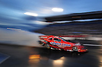 Oct. 31, 2008; Las Vegas, NV, USA: NHRA funny car driver Bob Tasca III does a burnout during qualifying for the Las Vegas Nationals at The Strip in Las Vegas. Mandatory Credit: Mark J. Rebilas-