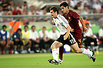 08 July 2006: Miroslav Klose (GER) (11) beats Ricardo Costa (POR) (4) for pace. Germany defeated Portugal 3-1 at the Gottlieb-Daimler Stadion in Stuttgart, Germany in match 63, the third-place game, of the 2006 FIFA World Cup.