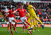 Fleetwood Town's Paddy Madden competes in the air with Barnsley's Cauley Woodrow<br /> <br /> Photographer Richard Martin-Roberts/CameraSport<br /> <br /> The EFL Sky Bet League One - Barnsley v Fleetwood Town - Saturday 13th April 2019 - Oakwell - Barnsley<br /> <br /> World Copyright &not;&copy; 2019 CameraSport. All rights reserved. 43 Linden Ave. Countesthorpe. Leicester. England. LE8 5PG - Tel: +44 (0) 116 277 4147 - admin@camerasport.com - www.camerasport.com