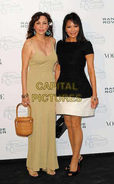 MARIE HELVIN & GUEST.Attends the Range Rover 40th Anniversary Party in association with Vogue at the Orangery, Kensington Palace, London, England, UK..July 1st 2010.full length beige nude maxi dress sleeveless basket woven bag black white.CAP/CJ.©Chris Joseph/Capital Pictures.