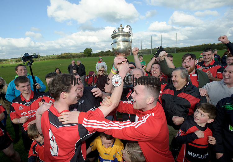 Meelick  captain Kevin Harnett delivers  the cup to his team mates following the win over Kilmurry Ibrickane in their Junior A  county final at Gurteen. Photograph by John Kelly.