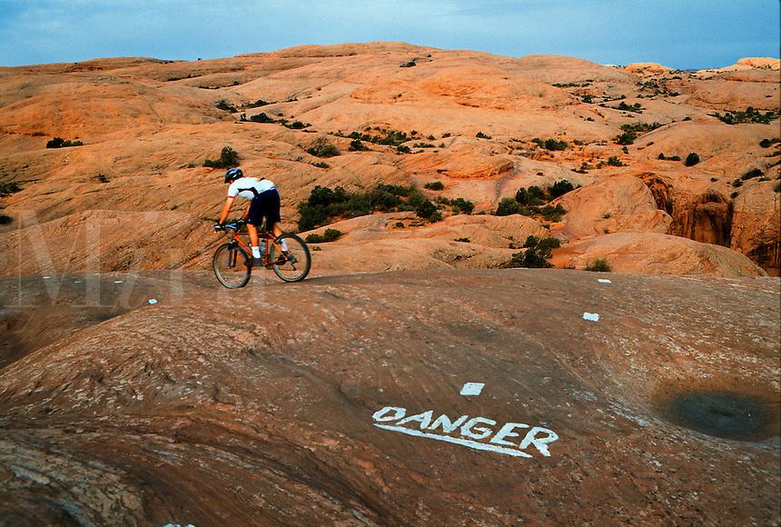 Montain biker on danger trail.