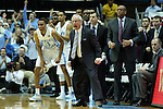 18 December 2013: UNC head coach Roy Williams (center) and Brice Johnson (11) react to a basket by their team. The University of North Carolina Tar Heels played the University of Texas Longhorns at the Dean E. Smith Center in Chapel Hill, North Carolina in a 2013-14 NCAA Division I Men's Basketball game. Texas won the game 86-83.