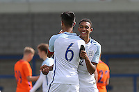 Trent Alexander Arnold (Liverpool) of England U19 embraces winning penalty shootout scorer Easah Suliman (Cheltenham Town on loan from Aston Villa) of England U19 as the game ends 1-1 (9-8 Penalties) during the International match between England U19 and Netherlands U19 at New Bucks Head, Telford, England on 1 September 2016. Photo by Andy Rowland.