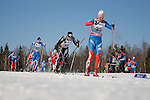 FALUN, SWEDEN - March 23: (R-L) Dmitriy Japarov of Russia (RUS), Dario Cologna of Switzerland (SUI) and Matti Heikkinen of Finland (FIN) during the Viessmann Men Classic Mass start 15km race at the FIS Cross Country World Cup Final on March 23, 2013 in Falun, Sweden. The race was won by Eldar Roenning of Norway (NOR) , 2nd place Maxim Vylegzhanin of Russia (RUS) and 3rd place Martin Johnsrud Sundby of Norway (NOR). (Photo by Dirk Markgraf)