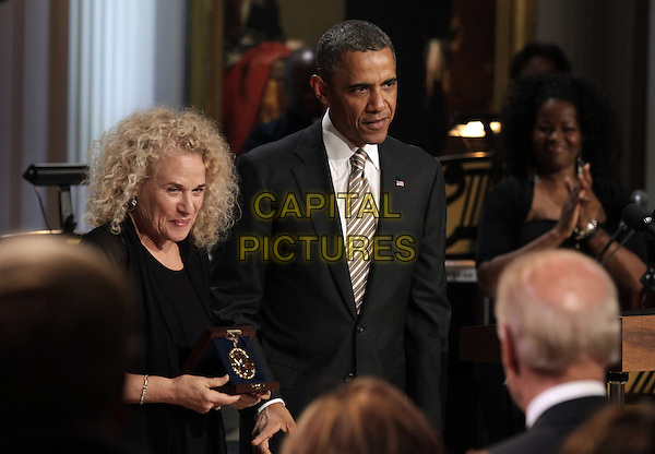 United States President Barack Obama awards  singer-songwriter Carole King the 2013 Library of Congress Gershwin Prize for Popular Song during a concert at the White House in Washington, DC on May 22, 2013. .half length black suit grey gray stripe tie .CAP/ADM/CNP/YG.©Yuri Gripas/CNP/AdMedia/Capital Pictures.