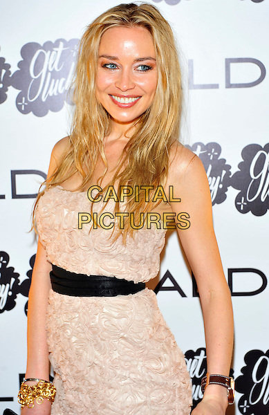 Noelle Reno.At the Aldo a/w 2011 collection party, One Marylebone, London, England, UK ..21st June 2011.half length strapless beige dress lace  black waistband belt smiling nude.CAP/CJ.©Chris Joseph/Capital Pictures.