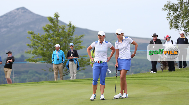 The Sugar Loaf plays a stunning backdrop on hole 4 as Meghan MacLaren and Maria Dunne wait to putt out during Friday Foursomes at the 2016 Curtis Cup, played at Dun Laoghaire GC, Enniskerry, Co Wicklow, Ireland. 10/06/2016. Picture: David Lloyd | Golffile. <br /> <br /> All photo usage must display a mandatory copyright credit to &copy; Golffile | David Lloyd.
