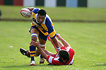 Jeff Maka tries to push G. Fulcher off as he steps over him. Counties Manukau Premier Club Rugby, Patumahoe vs Karaka played at Patumahoe on Saturday 22nd April 2006. Karaka won 19 - 6.