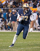 Pitt running back Qadree Ollison. The Pitt Panthers football team defeated the Louisville Cardinals 45-34 on Saturday, November 21, 2015 at Heinz Field, Pittsburgh, Pennsylvania.