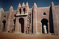 World Civilization:  African Adobe Architecture--Courtyard of the Mosque of San, Mali.  To left of ladder, an empty niche called a Mihrab, facing Mecca.  Photo '91.
