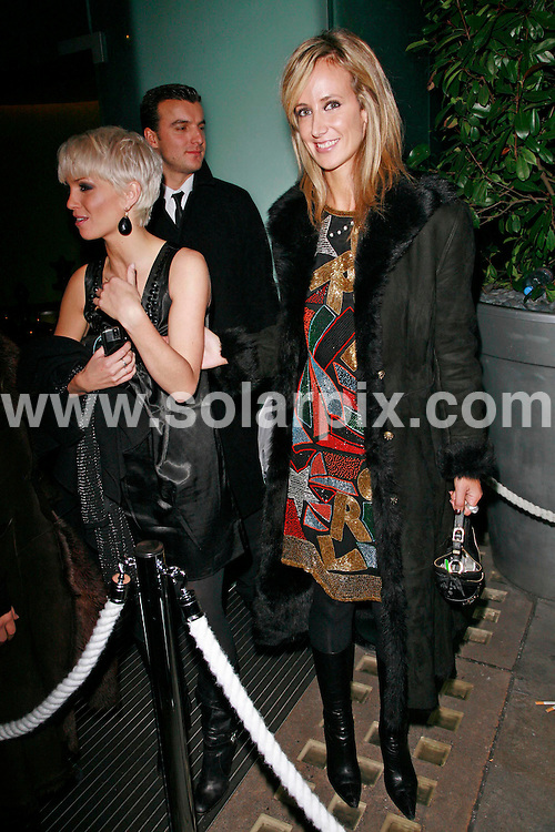 **ALL ROUND PICTURES FROM SOLARPIX.COM**.*WORLDWIDE RIGHTS*.Sarah Harding (Girls Aloud) leaves the Embassy nightclub with Lady Victoria Hervey after a few drinks inside. They both get a taxi with another friend and go to the nightclub, Bungalow 8, where they leave just before 2:30am in a taxi. .Sarah pulls her tongue at photographers playfully as she enters Bungalow 8 nightclub..JOB REF:  5201  GMT   DATE: 26.10.07.**MUST CREDIT SOLARPIX.COM OR DOUBLE FEE WILL BE CHARGED* *UNDER NO CIRCUMSTANCES IS THIS IMAGE TO BE REPRODUCED FOR ANY ONLINE EDITION WITHOUT PRIOR PERMISSION*