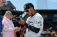 Akron RubberDucks shortstop Francisco Lindor (12) signs autographs before a game against the Erie SeaWolves on May 18, 2014 at Jerry Uht Park in Erie, Pennsylvania.  Akron defeated Erie 2-1.  (Mike Janes/Four Seam Images)