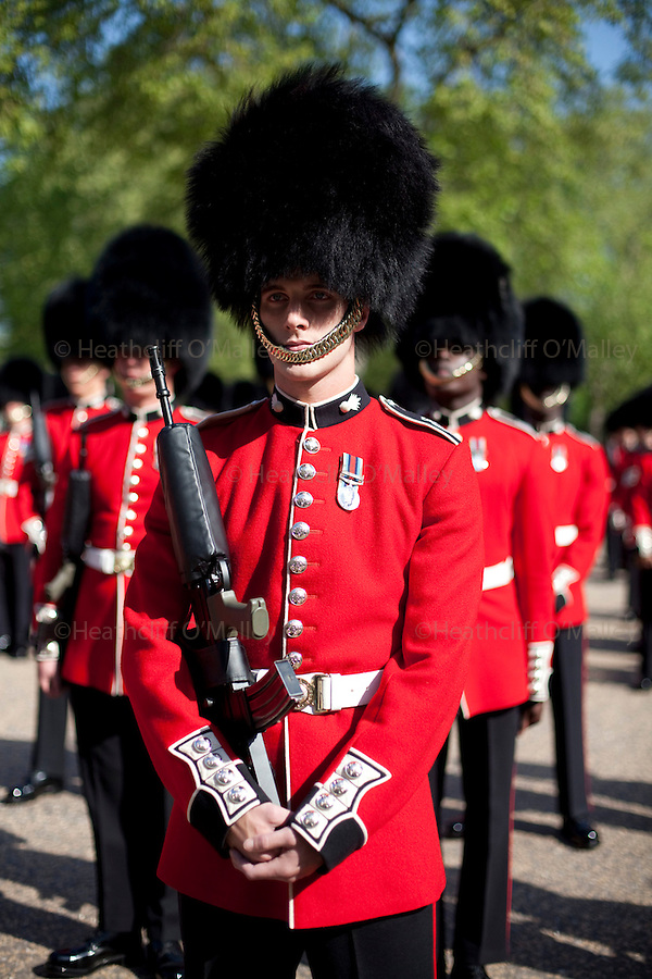 Mcc0023074 . Daily Telegraph..The Grenadier Guards at Wellington Barracks  preparing for Trooping the Colour in celebration of the Queen's Birthday on June 12 ..The Grenadier Guards only recently finished a six month tour of Helmand , Afghanistan on March 31...London 19 June 2010......Not AP.Not Reuters.Not PA.Not Getty.Not AFP.