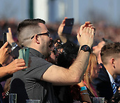 14h April 2018, Aintree Racecourse, Liverpool, England; The 2018 Grand National horse racing festival sponsored by Randox Health, day 3;  winning punters cheer Richard Johnson on Thomas Patrick to win The Betway Handicap Steeple Chase