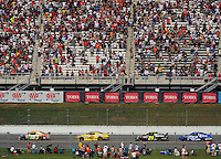 Apr 27, 2008; Talladega, AL, USA; NASCAR Sprint Cup Series driver Kyle Busch (18) leads Juan Pablo Montoya (42) and Jeff Gordon (24) during the Aarons 499 at Talladega Superspeedway. Mandatory Credit: Mark J. Rebilas-