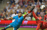 Jose Calderon (12) of Panama reaches for the ball just after Jozy Altidore (17) of the United States did a bicycle kick and scored during their Gold Cup match on June 26, 2019 at Children's Mercy Park in Kansas City, KS.<br /> Tim VIZER/AFP