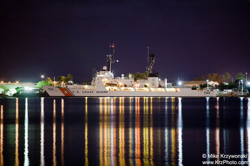 U.S. Coast Guard ship in the Honolulu Harbor at night, O'ahu