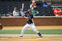 Joey Rodriguez (8) of the Wake Forest Demon Deacons at bat against the Miami Hurricanes at Wake Forest Baseball Park on March 22, 2015 in Winston-Salem, North Carolina.  The Demon Deacons defeated the Hurricanes 10-4.  (Brian Westerholt/Four Seam Images)