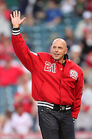 Former Los Angeles Angel Wally Joyner waves to the crowd after throwing out the first pitch before game against the Atlanta Braves at Angel Stadium in Anaheim,California on May 21, 2011. Photo by Larry Goren/Four Seam Images