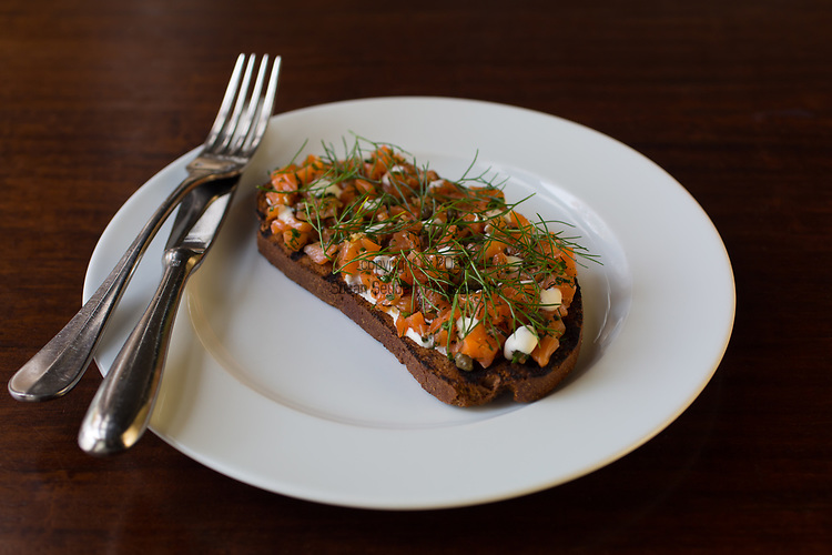 house cured salmon tartine, crème fraîche, fennel at Cafe Castagna, a restaurant in SE Portland, Oregon, USA