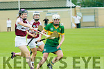 Kerry's  Patrice Diggin gets away from Westmeath's Aoife Higgins and Fiona Leavy  at the Kerry v Westmeath Camogie match at Abbeydorney GAA field on Sunday