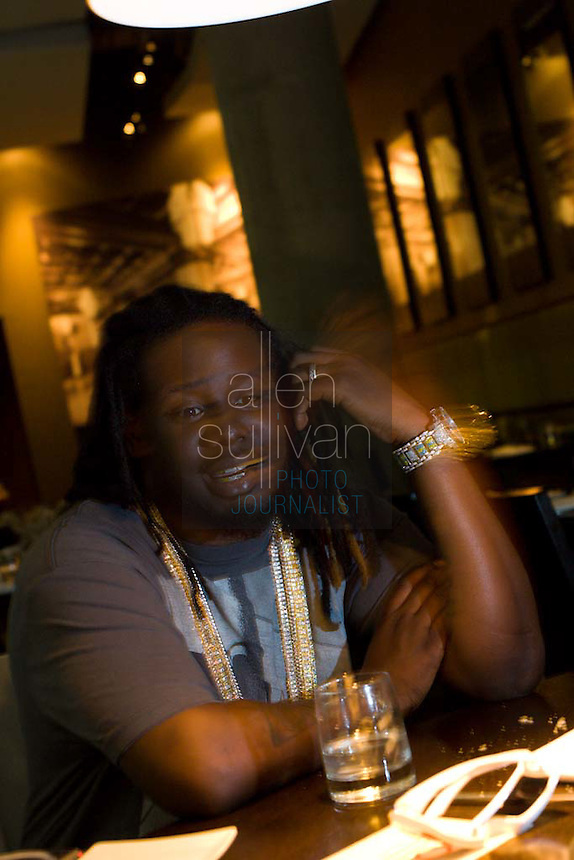 """Rapper and R & B artist T-Pain, whose """"Buy U a Drank (Shawty Snappin')"""" has hit the top of the charts, at the Lobby at Twelve in Atlanta, Georgia on Wednesday, May 23, 2007."""