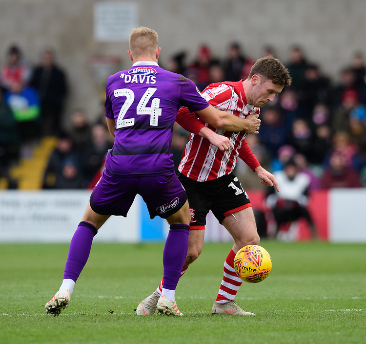 Lincoln City's Shay McCartan is fouled by Grimsby Town's Harry Davis<br /> <br /> Photographer Chris Vaughan/CameraSport<br /> <br /> The EFL Sky Bet League Two - Lincoln City v Grimsby Town - Saturday 19 January 2019 - Sincil Bank - Lincoln<br /> <br /> World Copyright &copy; 2019 CameraSport. All rights reserved. 43 Linden Ave. Countesthorpe. Leicester. England. LE8 5PG - Tel: +44 (0) 116 277 4147 - admin@camerasport.com - www.camerasport.com