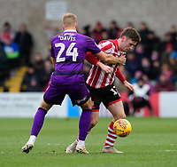 Lincoln City's Shay McCartan is fouled by Grimsby Town's Harry Davis<br /> <br /> Photographer Chris Vaughan/CameraSport<br /> <br /> The EFL Sky Bet League Two - Lincoln City v Grimsby Town - Saturday 19 January 2019 - Sincil Bank - Lincoln<br /> <br /> World Copyright © 2019 CameraSport. All rights reserved. 43 Linden Ave. Countesthorpe. Leicester. England. LE8 5PG - Tel: +44 (0) 116 277 4147 - admin@camerasport.com - www.camerasport.com
