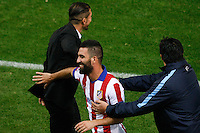 Atletico de Madrid´s Arda Turan with Diego Pablo Simeone and second coach Mono Burgos during Champions League soccer match between Atletico de Madrid and Malmo at Vicente Calderon stadium in Madrid, Spain. October 22, 2014. (ALTERPHOTOS/Victor Blanco)