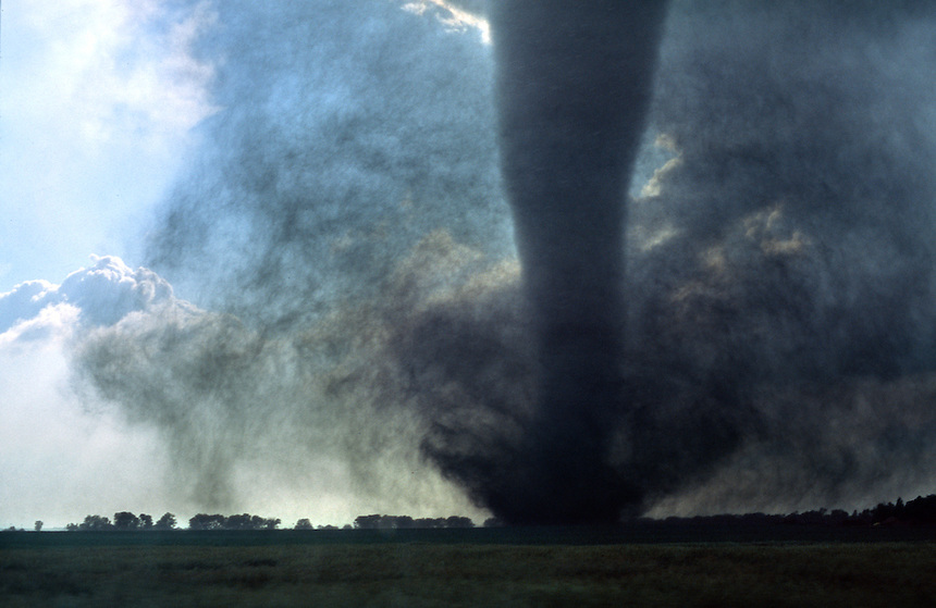 A dramatic close view of dirt and debris lofted into the air by a strong tornado near Woonsocket South Dakota on June 24th, 2003. This storm destroyed a farmstead and damaged many crops in the area.