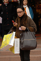 A shopper leaves the Teem Plaza shopping centre in the  Tien He District of Guangzhou, China.                                                                                                                               .04 Jan 2007