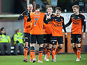 Dundee Utd's Jaroslaw Fojut (left) celebrates after he scores their second goal.