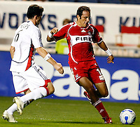 Chicago Fire midfielder Cuauhtemoc Blanco (10) prepares to cross the ball in front of New England defender Jay Heaps (6). The Chicago Fire defeated the New England Revolution 2-1 at Toyota Park in Bridgeview, IL on October 6, 2007.